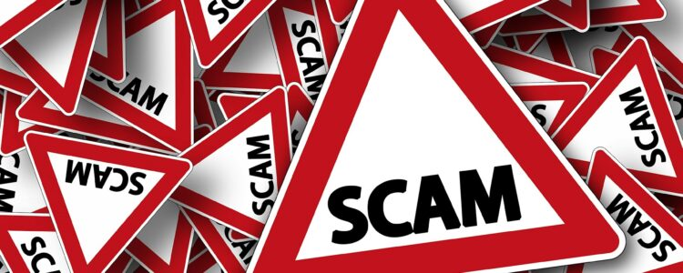 Red And White Road Signs With The Word SCAM Pro Tax & Accounting Blog