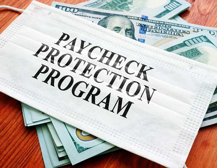 Money With A Mask On Top With The Words Paycheck Protection Program Written On The Mask